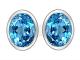 Original Star K™ 8x6mm Oval Simulated Blue Topaz Earrings Studs style: 307071