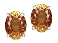 Original Star K™ Oval 8x6mm Simulated Imperial Yellow Topaz Earring Studs