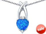 Original Star K™ 8mm Heart Shape Created Blue Opal Cross Heart Pendant style: 306827