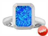 Original Star K™ 9x7mm Emerald Cut Octagon Solitaire Engagement Ring With Created Blue Opal style: 306959