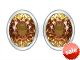Original Star K™ 8x6mm Oval Simulated Imperial Yellow Topaz Earrings Studs style: 307084