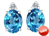 Original Star K™ 8x6mm Oval Genuine Blue Topaz Earrings Studs style: 307194