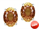 Original Star K™ Oval 8x6mm Simulated Imperial Yellow Topaz Earrings Studs style: 307525