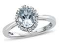 10kt White Gold Oval Aquamarine with White Topaz accent stones Halo Ring