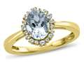 10kt Yellow Gold 8x6mm Oval Aquamarine with White Topaz accent stones Halo Ring