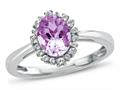 Finejewelers 10k White Gold 8x6mm Oval Created Pink Sapphire with White Topaz accent stones Halo Ring