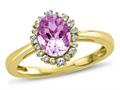 Finejewelers 10k Yellow Gold 8x6mm Oval Created Pink Sapphire with White Topaz accent stones Halo Ring