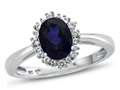 10kt White Gold Oval Created Sapphire with White Topaz accent stones Halo Ring