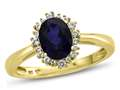 10kt Yellow Gold Oval Created Sapphire with White Topaz accent stones Halo Ring