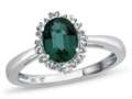 10kt White Gold Oval Created Emerald with White Topaz accent stones Halo Ring