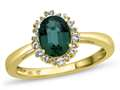 10kt Yellow Gold Oval Created Emerald with White Topaz accent stones Halo Ring