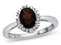 10k White Gold 8x6mm Oval Garnet with White Topaz accent stones Halo Ring