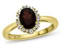 10kt Yellow Gold  8x6mmOval Garnet with White Topaz accent stones Halo Ring