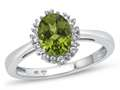 10kt White Gold Oval Peridot with White Topaz accent stones Halo Ring