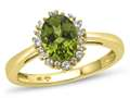 10kt Yellow Gold Oval Peridot with White Topaz accent stones Halo Ring