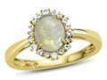 10kt Yellow Gold Oval Opal with White Topaz accent stones Halo Ring