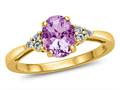 Finejewelers 10k Yellow Gold 8x6mm Oval Created Pink Sapphire and White Topaz Ring