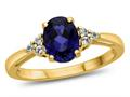 Finejewelers 10k Yellow Gold 8x6mm Oval Created Blue Sapphire and White Topaz Ring