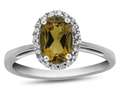 10kt White Gold 7x5mm Oval Citrine with White Topaz accent stones Halo Ring