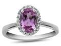 10kt White Gold 7x5mm Oval Created Pink Sapphire with White Topaz accent stones Halo Ring