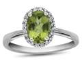 10kt White Gold 7x5mm Oval Peridot with White Topaz accent stones Halo Ring