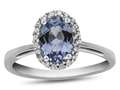 10k White Gold 7x5mm Oval Simulated Aquamarine with White Topaz accent stones Halo Ring