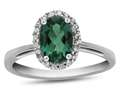 10kt White Gold 7x5mm Oval Simulated Emerald with White Topaz accent stones Halo Ring