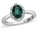 10kt White Gold Oval Created Emerald with White Topaz accent stones Halo Ring style: R10563SPMUL510KW