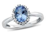 Finejewelers 10k White Gold 8x6mm Oval Swiss Blue Topaz with White Topaz accent stones Halo Ring style: R10563SPMUL810KW