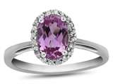 10k White Gold 7x5mm Oval Created Pink Sapphire with White Topaz accent stones Halo Ring style: R1079403