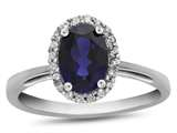 10k White Gold 7x5mm Oval Created Sapphire with White Topaz accent stones Halo Ring style: R1079405