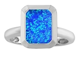 Star K™ 9x7mm Emerald Cut Octagon Solitaire Ring With Simulated Blue Opal style: 306959